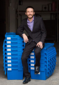 Jesse Meyer sitting on clue boxes