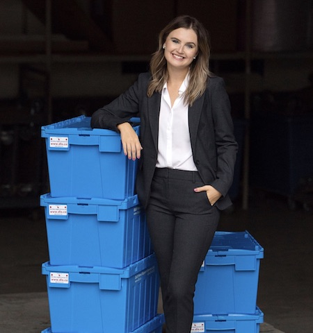 DLO office moving experts - DLO team member Johanna Kuffner in front of blue boxes