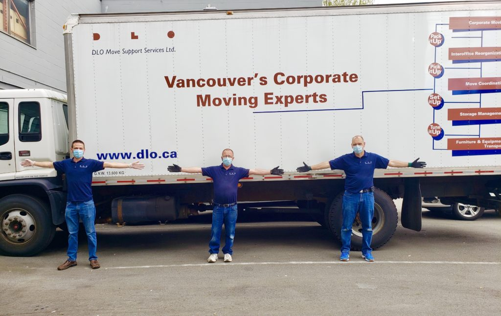 DLO office moving experts - DLO team social distancing in front of truck